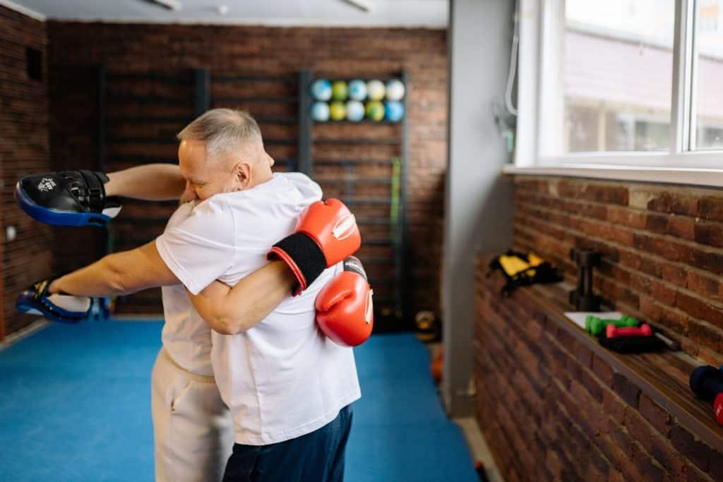 why do boxers hug